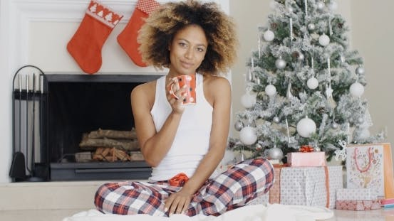 Thumbnail for Smiling Young Woman Enjoying a Cup Of Xmas Coffee