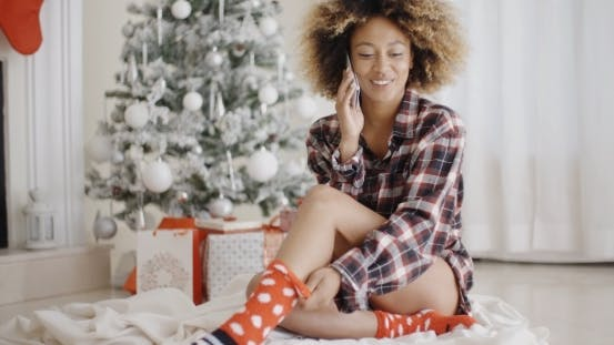 Thumbnail for Young Woman Relaxing In Front Of a Christmas Tree