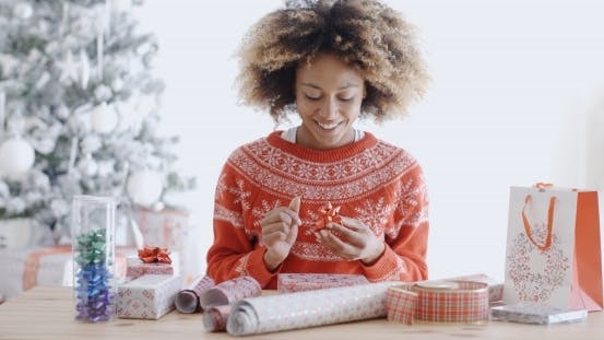 Thumbnail for Attractive Young Woman Wrapping Christmas Gifts