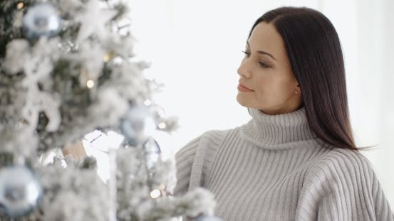 Thumbnail for Pretty Young Woman Decorating Her Christmas Tree