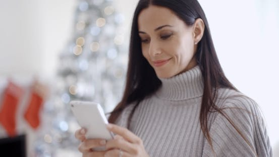 Thumbnail for Attractive Young Woman Reading a Text Message