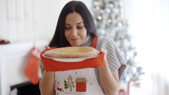 Thumbnail for Attractive Young Woman Baking Tarts For Xmas