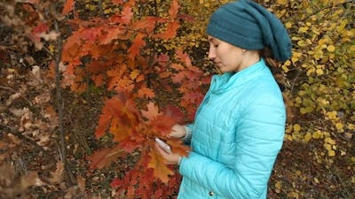 Girl Tearing Leaves