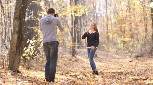 Woman Photographing Man