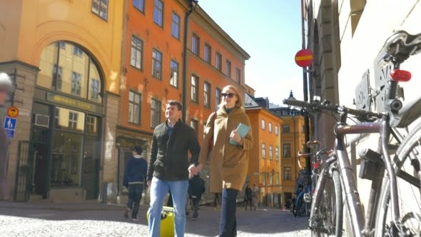 Thumbnail for Couple Of Tourists Walking Around The City