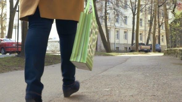 Thumbnail for Woman Walking With Green Shopping Bag