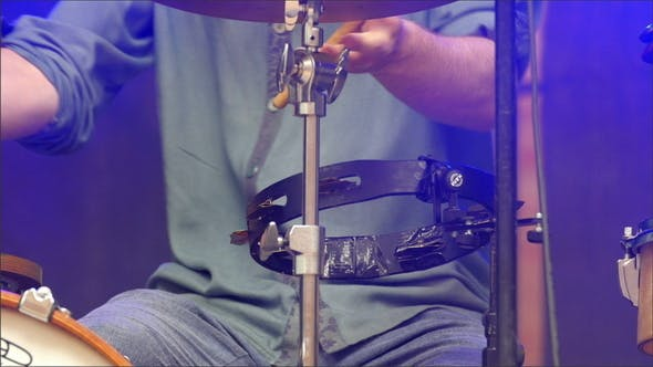 Thumbnail for A Man in Jeans Practicing his Drums