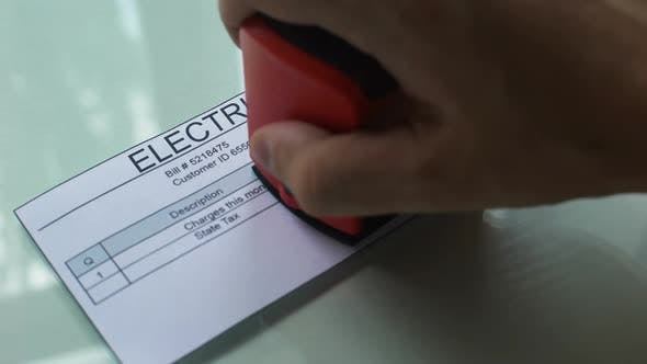 Thumbnail for Past Due Electricity Bill, Hand Stamping Seal on Document, Payment for Services