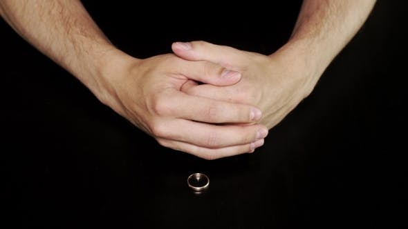 Thumbnail for Mans Hands Takes Off a Ring Put On Black Table