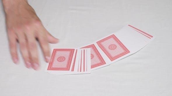 Hands Shuffling Deck Of Cards And Dealing