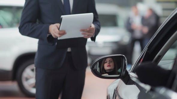 Thumbnail for Woman Talking To Car Salesman