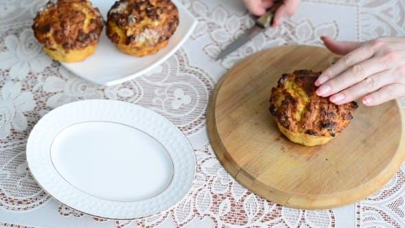 Thumbnail for Woman Cuts Hot Homemade Cupcake