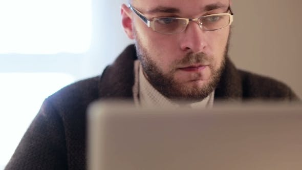 Thumbnail for Man Working On Laptop Computer In The Workplace