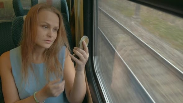 Thumbnail for Woman With Pocket-Glass In Train