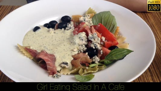 Thumbnail for Girl Eating Salad In A Cafe 10