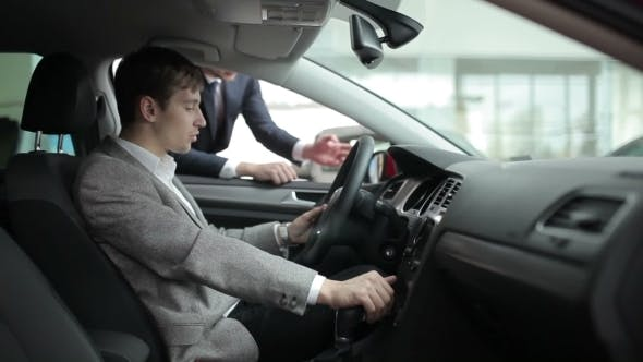Thumbnail for Man Inspecting Interior Of The Car