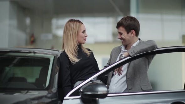 Thumbnail for Happy Young Couple In Car Dealership