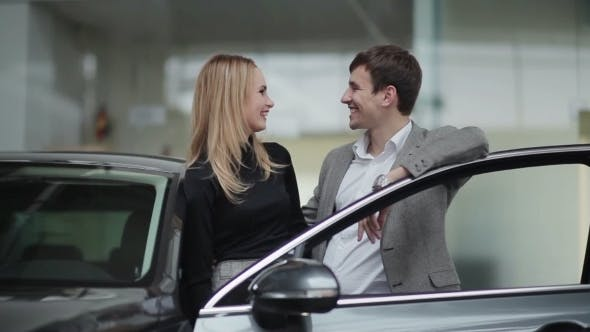 Thumbnail for Young Couple Rejoicing Buying a Car