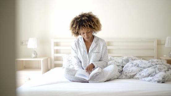 Thumbnail for Woman Reading A Book On Bed