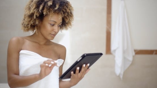 Thumbnail for Woman Using Tablet Computer In The Bath