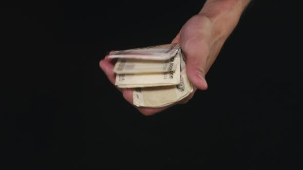 Hands Showing Of a Lot Of Money