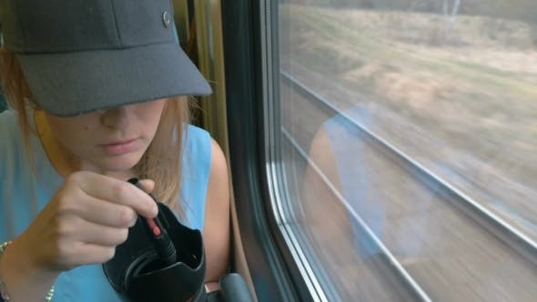 Thumbnail for Young Woman Taking A Photo On Train