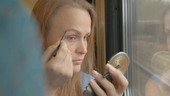 Thumbnail for Woman Going By Train And Putting On Make-up