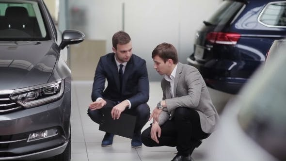 Thumbnail for Two Young Guys Discussing Car Specification