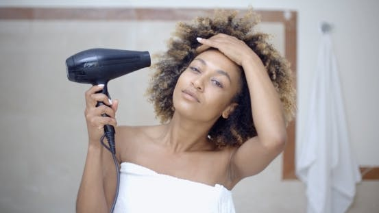 Thumbnail for Woman Drying Her Hair With Hairdryer