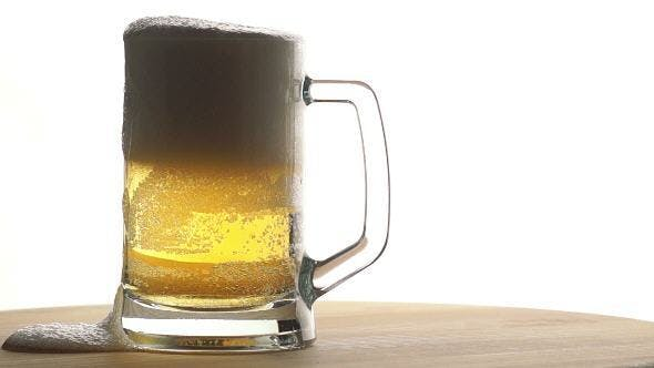 Thumbnail for Beer is Poured into a Mug