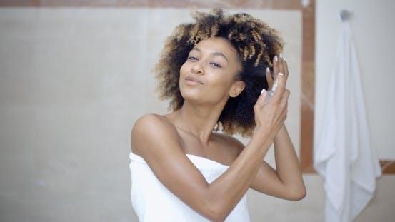 Thumbnail for Woman Using Hair Spray In Bathroom