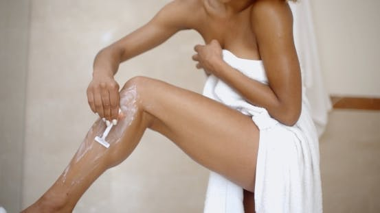 Thumbnail for Young Woman Is Shaving Her Leg