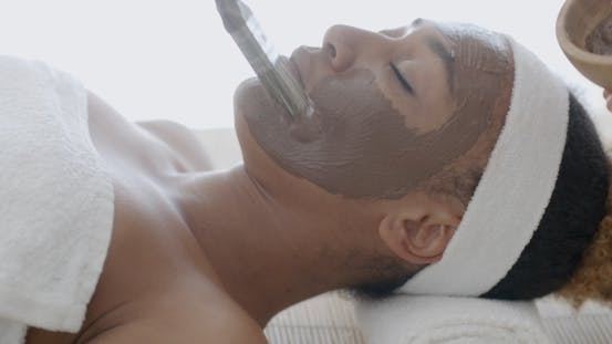 Thumbnail for Woman With Clay Facial Mask In Spa