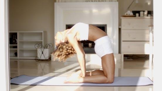 Thumbnail for Female Doing Yoga In Her Living Room