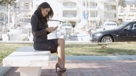 Thumbnail for Young Businesswoman With Smartphone