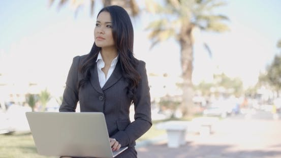 Thumbnail for Young Business Woman Working On A Laptop