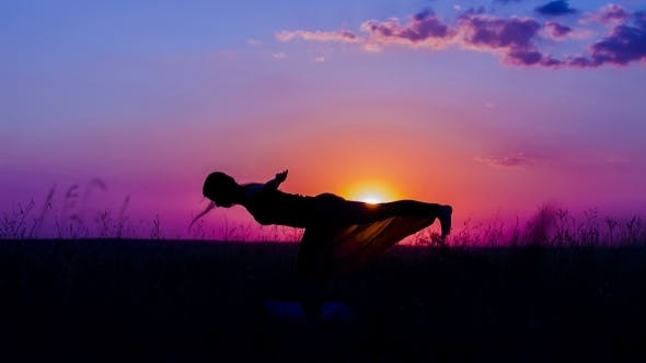 Silhouette Of a Young Girl Practicing Yoga Asanas