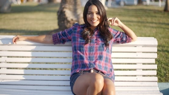 Thumbnail for Girl Relaxing On Bench In Park