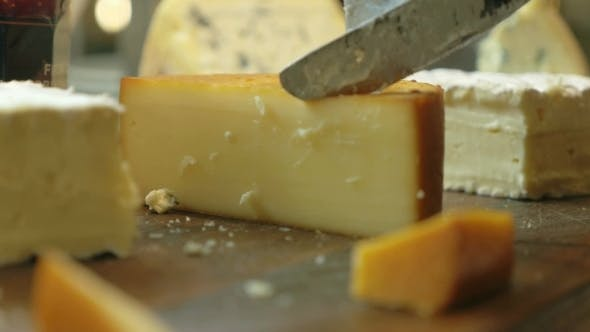 Thumbnail for Cutting a Serving From The Cheese