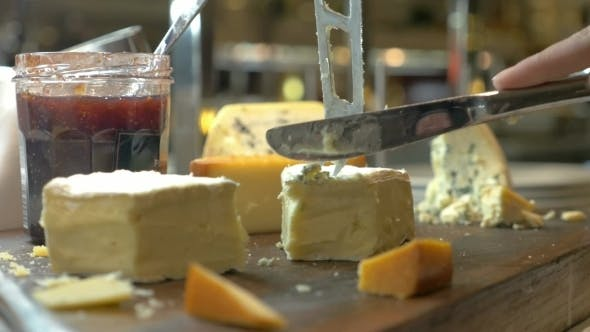 Thumbnail for Hands Cutting Soft Cheese With Knife