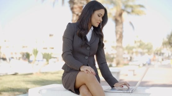 Business Woman With Laptop Sitting On The Bench