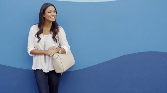 Thumbnail for Stylish Cool Girl Against A Blue Wall