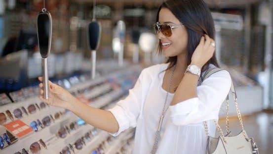 Thumbnail for Woman In Optical Store Choosing Eyeglasses