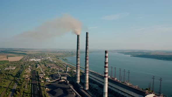 Thumbnail for Aerial Drone View of High Chimney Pipes with Grey Smoke From Coal Power Plant. Close Up