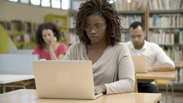 Thumbnail for Front View of Serious African American Woman Using Laptop