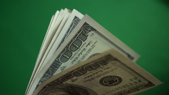 Thumbnail for Lot Of 100 Dollar Bills Isolated On Chroma Key Green Screen Background