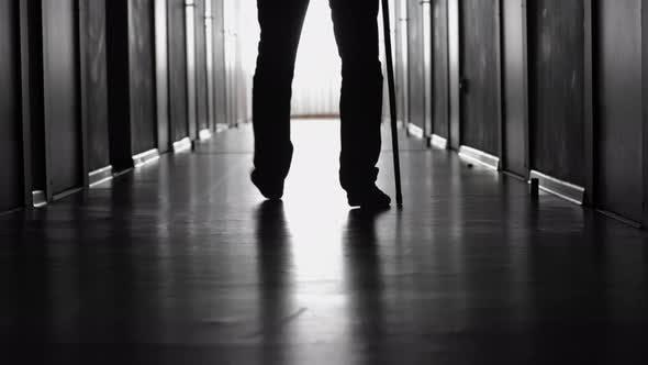 Thumbnail for Man Limping along Hospital Corridor