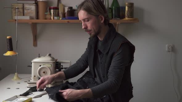 Thumbnail for Handsome Man Tailor Working in Sewing Workshop