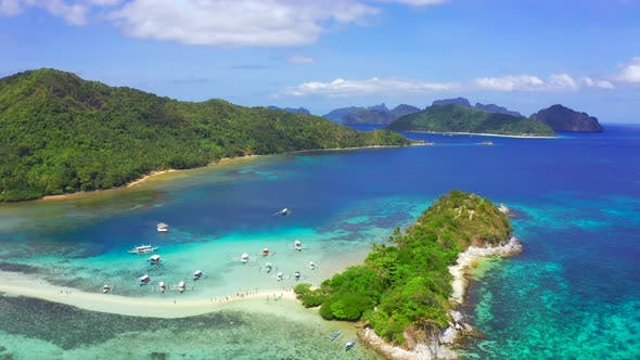 Thumbnail for Boats Moored at Turquoise Coastal Waters and Coral Reef in El Nido Archipelago Tourist Destination