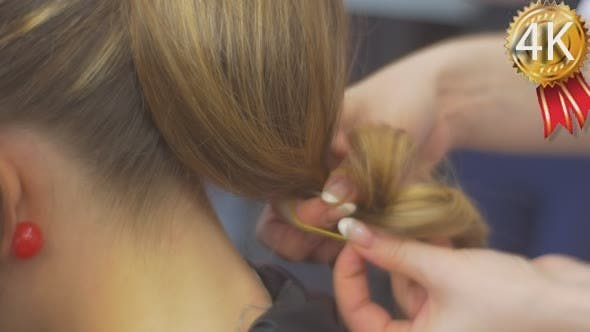 Thumbnail for Stylist Hairdresser Is Making a Hairstyle Fixing